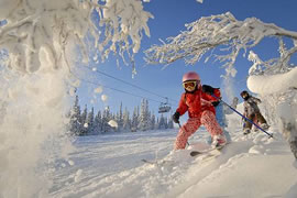 Children enjoying skiing in Norway's Lillehammer Valley